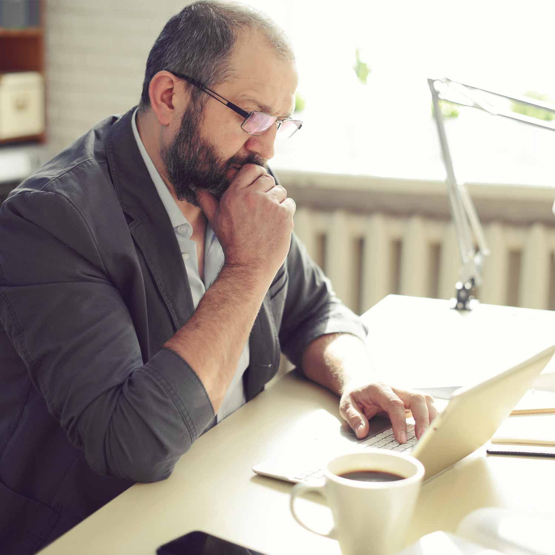 pensive_man_looking_at_laptop