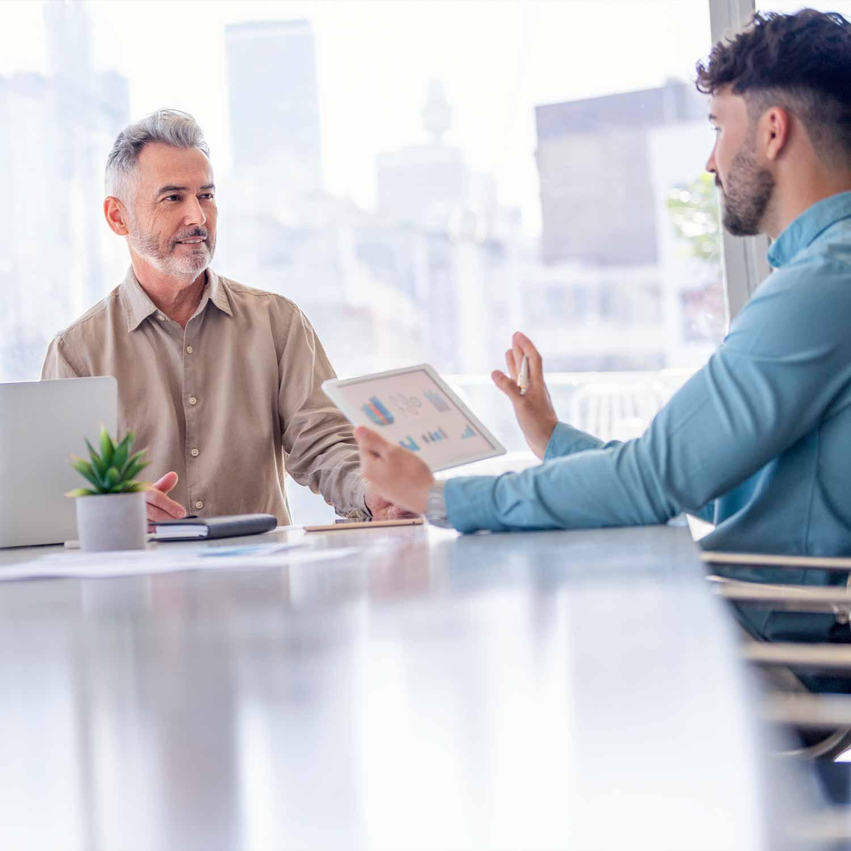 two_men_talking_data_analytics